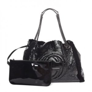 With popping distressed patent leather and shearling trim this Gucci bag is the epitome of laid-back luxury.