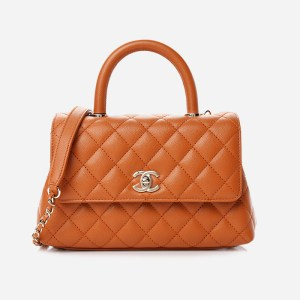 A product image of the Chanel Caviar Quilted Mini Coco Handle Flap in Caramel