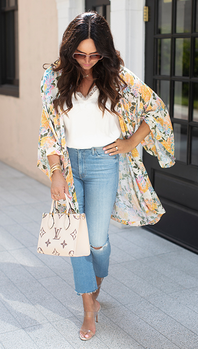 Lifestyle photo Chantelle Malarkey Louis wearing her Vuitton On The Go PM tote FASHIONPHILE