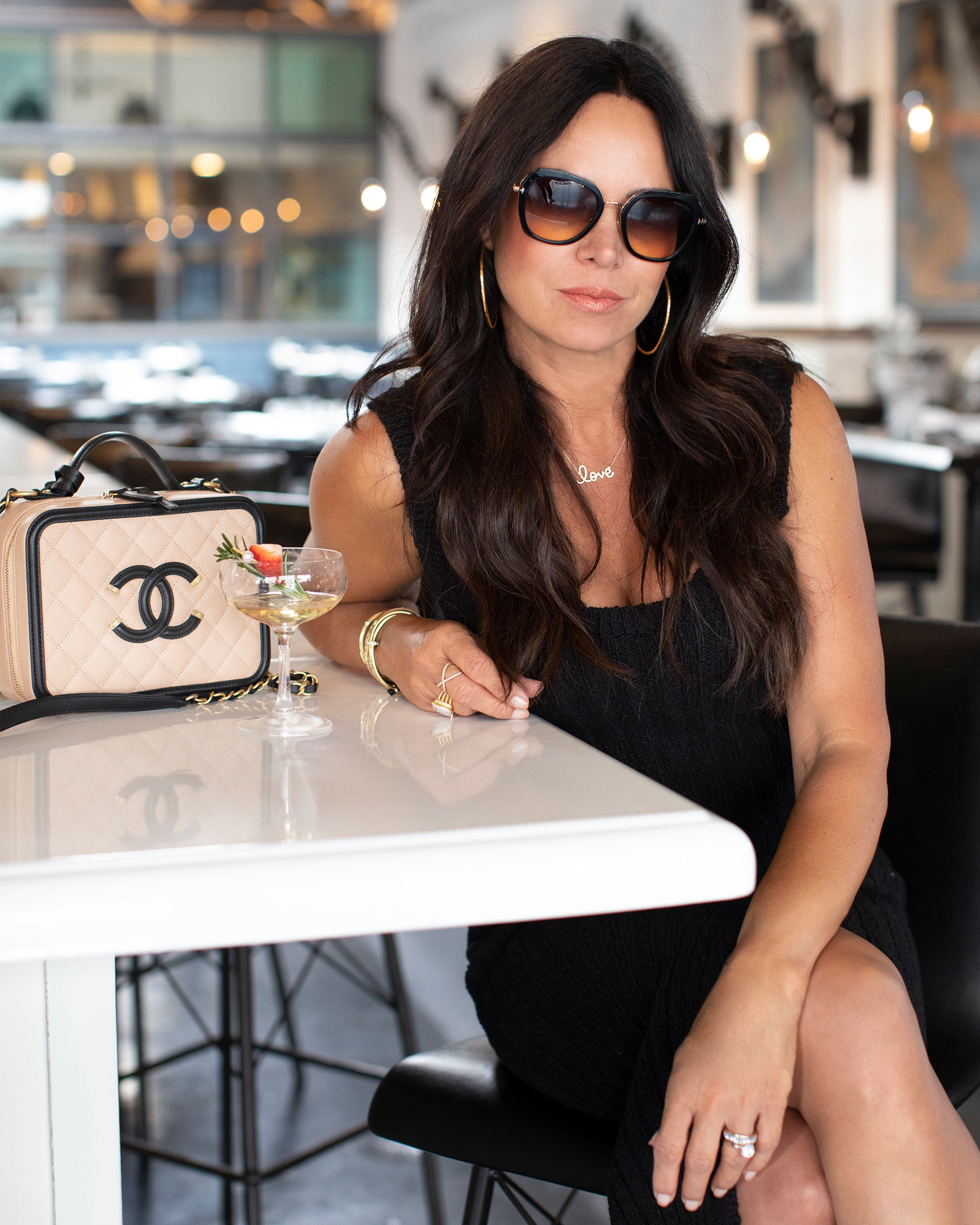Lifestyle image of Chantelle Malarkey with her Chanel Vanity Case from FASHIONPHILE