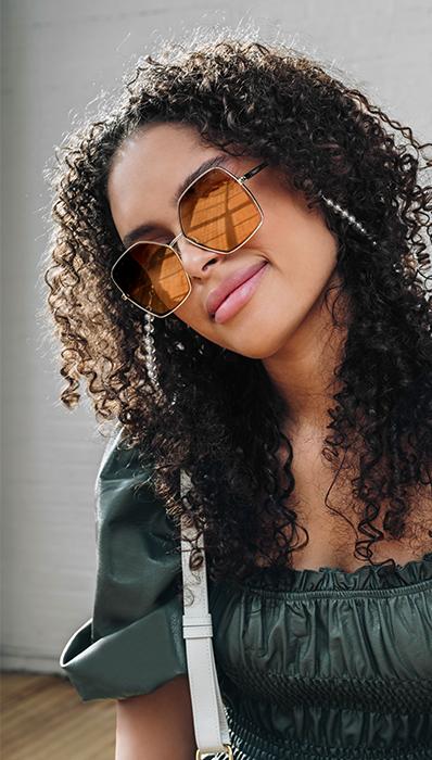 Lifestyle image of model in her designer sunglasses FASHIONPHILE