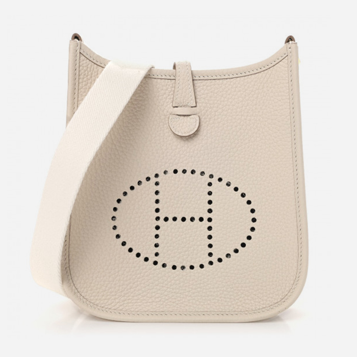 Product image of white Hermes Evelyne bag at FASHIONPHILE