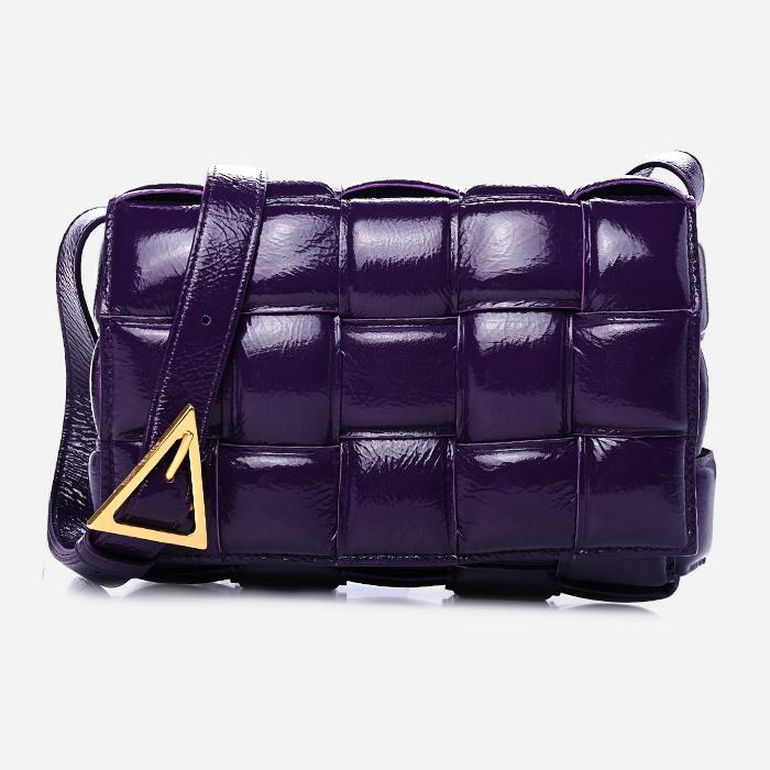 product image of textured deerskin padded cassette bottega veneta bag in purple FASHIONPHILE
